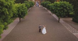 Aerial view: beautiful couple walking at the antique big castle 4k. Resolution stock video