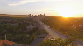 Aerial view: beautiful couple walking at the antique big castle 4k. Aerial view: beautiful wedding couple walking on at the antique castle. 4k stock video