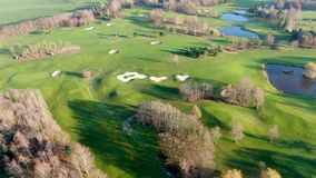 Aerial view of a beautiful green golf course stock video