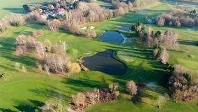 Aerial view of a beautiful green golf course stock video footage