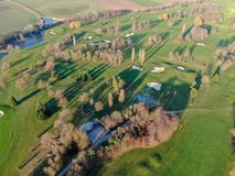 Aerial view of a beautiful green golf course. During winter time in South of Belgium, Europe stock images