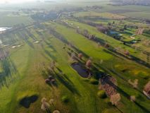 Aerial view of a beautiful green golf course. During winter time in South of Belgium, Europe royalty free stock photos
