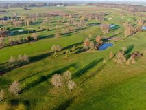 Aerial view of a beautiful green golf course. During winter time in South of Belgium, Europe stock photography