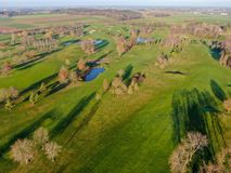 Aerial view of a beautiful green golf course. During winter time in South of Belgium, Europe royalty free stock image