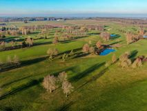 Aerial view of a beautiful green golf course. During winter time in South of Belgium, Europe royalty free stock photography
