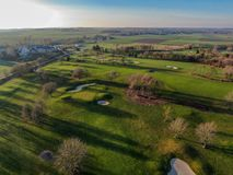 Aerial view of a beautiful green golf course. During winter time in South of Belgium, Europe stock photos