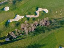 Aerial view of a beautiful green golf course. During winter time in South of Belgium, Europe royalty free stock photo