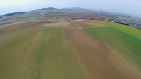 Aerial view of beautiful green landscape with cultivated fields and farmland. Stock footage stock footage