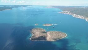 Aerial view of beautiful heart-shaped Island of Galesnjak, also called Island of Love, in Pasman channel, Croatia stock video