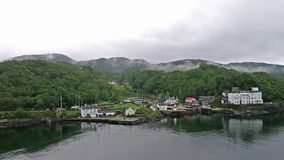 Aerial view of the beautiful historic harbour village of Crinan stock footage
