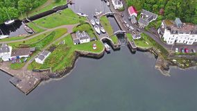 Aerial view of the beautiful historic harbour village of Crinan stock video footage