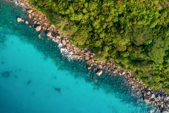 Aerial view of beautiful island at Seychelles in the Indian Ocean. Top view from drone.  stock photos