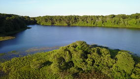 Aerial View of Beautiful Lake on Cape Cod. Aerial view of the peaceful, summer scenery in a freshwater lake on Cape Cod, Massachusetts. This peninsula has stock video