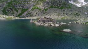 Aerial view of lake in mountains. Aerial view of beautiful lake in mountains stock video footage