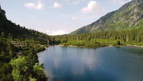 Aerial view of lake in mountains stock footage