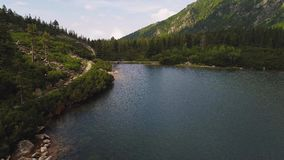 Aerial view of lake in mountains stock video