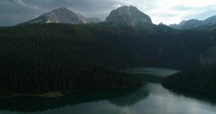 Aerial view at a beautiful lake in the mountains. Black Lake, Montenegro. stock footage