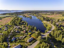 Aerial view of beautiful lake and village around it Royalty Free Stock Photo