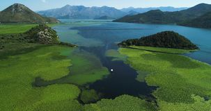 Aerial view of the beautiful landscape of Lake Skadar in the mountain on a sunny day. Montenegro. The territory of Lake