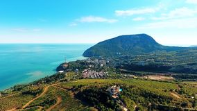 Aerial view on the beautiful landscape, sea, mountains, forest and blue sky. stock video