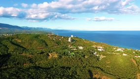 Aerial view on the beautiful landscape, sea, mountains, forest and blue sky. stock video footage
