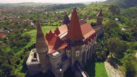 Aerial view of beautiful medieval castle on sunny day with beautiful green fields and hills stock video