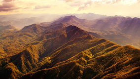 Aerial View of Beautiful Mountain Range. With warm sunlight Royalty Free Stock Image