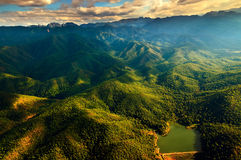 Aerial View of Beautiful Mountain Range. With warm sunlight during flight from Mae Hong Son province to Chiang Mai province, northern part of Thailand Royalty Free Stock Photos