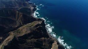 Flight over beautiful mountains near ocean shore stock video