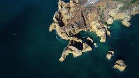 Flight over beautiful mountains near ocean shore stock video footage