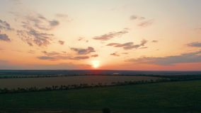Aerial view. Beautiful nature, view on rural countryside landscape and fields, shining sun sunset, sky, horizon. Aerial view. Beautiful nature, view on rural stock footage