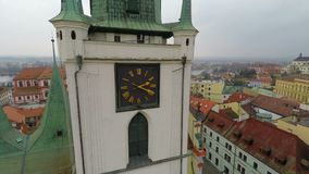 Aerial view of beautiful old clock on gothic city hall tower, historic landmark. Stock footage stock video