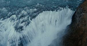 Aerial view of beautiful picturesque landscape in Iceland. Powerful waterfall Gullfoss falls down in mountains. stock footage