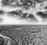 Aerial view of beautiful river across the forest.  Stock Photos