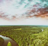 Aerial view of beautiful river across the forest.  Royalty Free Stock Photo