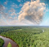 Aerial view of beautiful river across the forest.  Stock Photography