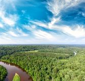 Aerial view of beautiful river across the forest.  Royalty Free Stock Image