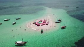 Aerial view of beautiful sand tropical island. With white sand beach and tourists. White sand island. Seascape: ocean and beautiful beach paradise. Zanzibar stock footage