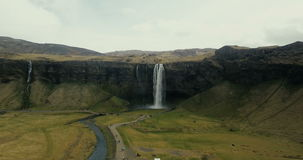 Aerial view of beautiful scenic landscape in Iceland. Powerful waterfall Seljalandsfoss falls down in mountains. stock video
