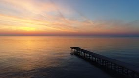 Aerial view of beautiful sunrise over the sea water and old bridge video.  stock footage