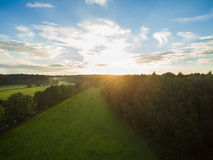 Aerial view of a beautiful sunset over rural landscape with forests and green fields. In germany Stock Photo