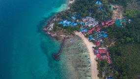 Aerial view of a beautiful tropical beach with some resorts in the sunrise. Perhentian Island, Malaysia. Aerial view of a beautiful tropical beach with some stock images