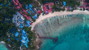 Aerial view of a beautiful tropical beach with some resorts in the sunrise. Perhentian Island, Malaysia. Aerial view of a beautiful tropical beach with some royalty free stock photos