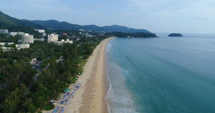 Aerial view of beautiful tropical blue sea and long beach from birds eye view, Karon Beach, Phuket island stock video footage