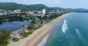 Aerial view of beautiful tropical blue sea and long beach from birds eye view, Karon Beach, Phuket island stock footage