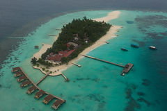Aerial view of beautiful tropical island at the ocean with luxury resort at Maldives Stock Photography