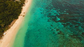 Aerial view beautiful tropical island and sand beach. Boracay island Philippines. Aerial view of beautiful tropical island with with azure water. Tropical stock video footage
