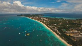 Aerial view beautiful beach on tropical island. Boracay island Philippines. Aerial view of beautiful tropical island with white sand beach, hotels and tourists stock footage