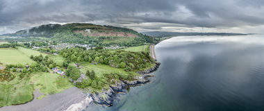 Aerial view of the beautiful village of Benderloch with dramatic skys Royalty Free Stock Photos