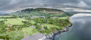 Aerial view of the beautiful village of Benderloch with dramatic skys Royalty Free Stock Images